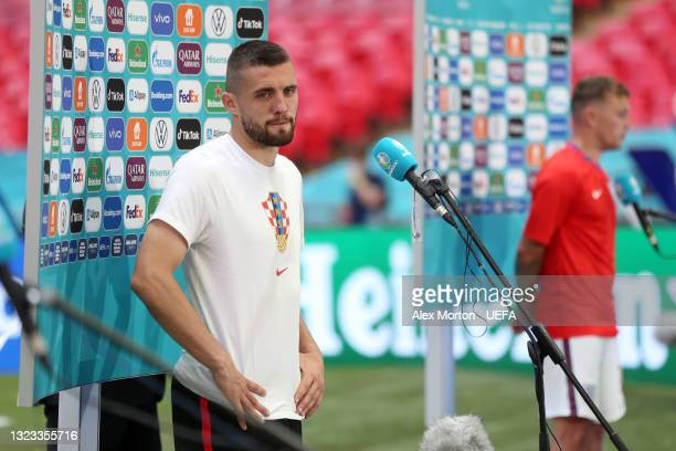 Mateo Kovacic of Croatia looks dejected as he speaks during a TV Interview after the UEFA Euro 2020 Championship Group D match between England and...