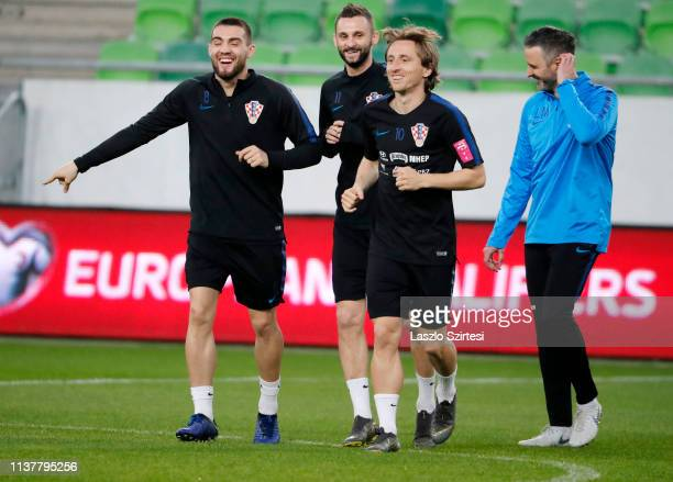 Mateo Kovacic of Croatia Marcelo Brozovic of Croatia and Luka Modric of Croatia and an unidentified person attend a training session ahead of the...