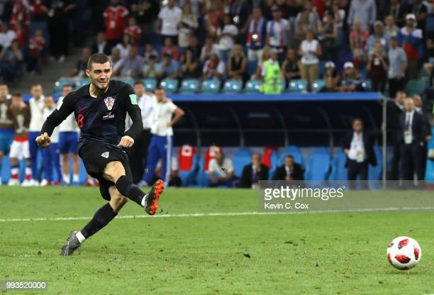 Mateo Kovacic of Croatia misses his team's second penalty in the penalty shoot out during the 2018 FIFA World Cup Russia Quarter Final match between...