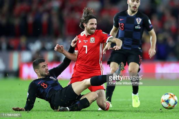 Mateo Kovacic of Croatia pulls Joe Allen of Wales down as he tackles him during the UEFA Euro 2020 qualifier between Wales and Croatia at Cardiff...
