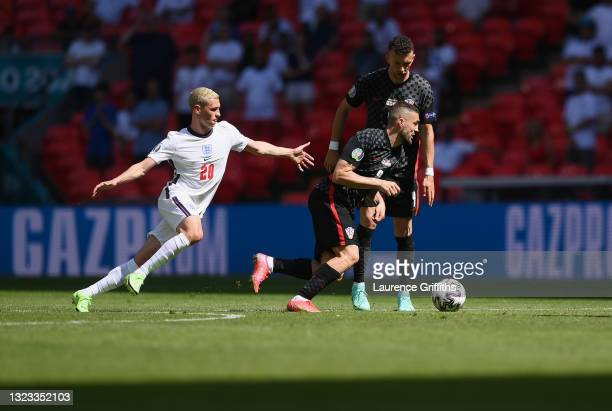 Mateo Kovacic of Croatia runs with the ball whilst under pressure from Phil Foden of England during the UEFA Euro 2020 Championship Group D match...