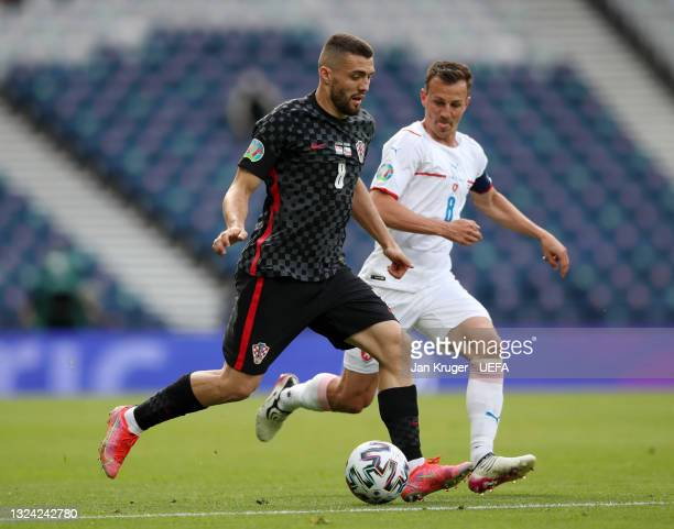 Mateo Kovacic of Croatia runs with the ball whilst under pressure from Vladimir Darida of Czech Republic during the UEFA Euro 2020 Championship Group...