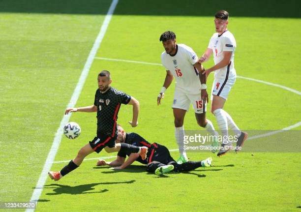 Mateo Kovacic of Croatia takes possession of the ball from Tyrone Mings and Declan Rice of England during the UEFA Euro 2020 Championship Group D...