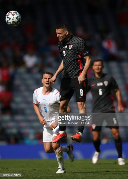 Mateo Kovacic of Croatia wins a header during the UEFA Euro 2020 Championship Group D match between Croatia and Czech Republic at Hampden Park on...