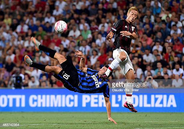 Mateo Kovacic of FC Internazionale and Keisuke Honda of AC Milan compete for the ball during the TIM preseason tournament match between FC...