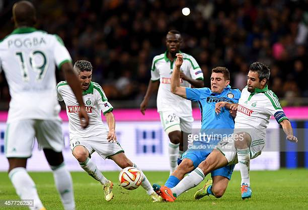 Mateo Kovacic of FC Internazionale and Loic Perrin of AS SaintEtienne compete for the ball during the UEFA Europa League group F match between FC...