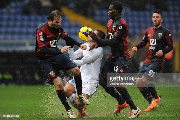 Mateo Kovacic of FC Internazionale Milano clashes with Giovanni Marchese and Isaac Cofie of Genoa CFC during the Serie A match between Genoa CFC and...