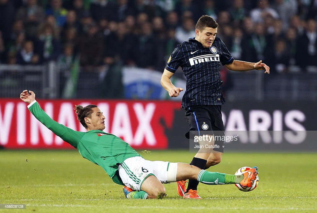 Mateo Kovacic of Inter Milan is tackled by Jeremy Clement of Saint-Etienne during the UEFA Europa League Group F match between AS Saint-Etienne and FC Internazionale Milano on November 6, 2014 in Saint-Etienne, France.