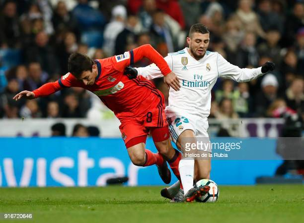 Mateo Kovacic of Real Madrid and Adnan Januzaj of Real Sociedad compete for the ball during the La Liga match between Real Madrid and Real Sociedad...