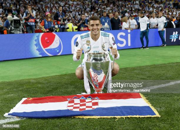 Mateo Kovacic of Real Madrid celebrates with The UEFA Champions League trophy following his sides victory in the UEFA Champions League Final between...