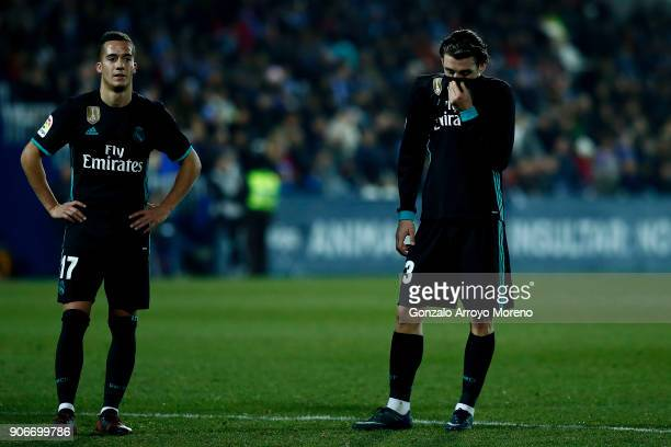 Mateo Kovacic of Real Madrid CF and his teammate Lucas Vazquez reacts during the Copa del Rey quarter final first leg match between Real Madrid CF...