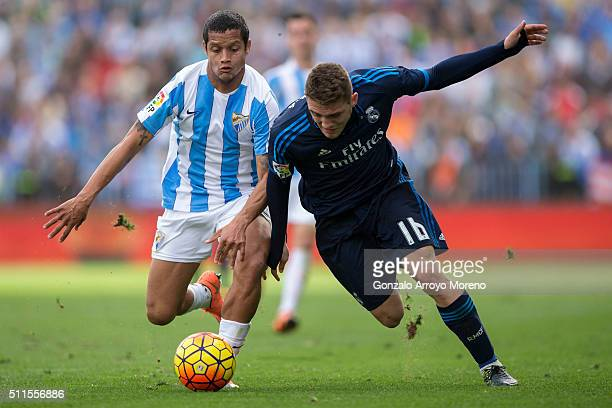 Mateo Kovacic of Real Madrid CF competes for the ball with Roberto Rosales of Malaga CF during the La Liga match between Malaga CF and Real Madrid CF...