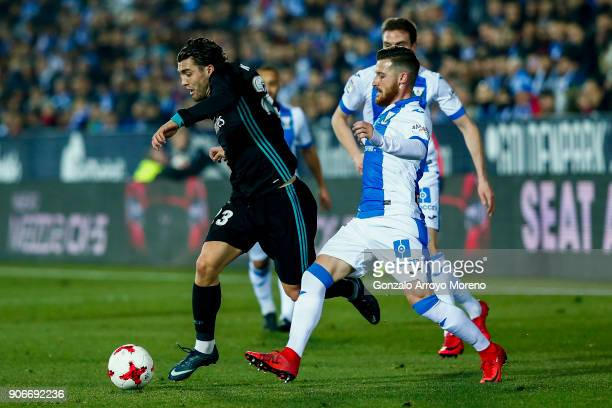 Mateo Kovacic of Real Madrid CF competes for the ball with Roberto Roman Triguero alias Tito of Deportivo Leganes during the Copa del Rey quarter...