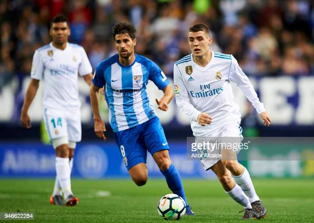 Mateo Kovacic of Real Madrid competes for the ball with Adrian Gonzalez of Malaga during the La Liga match between Malaga CF and Real Madrid CF at...