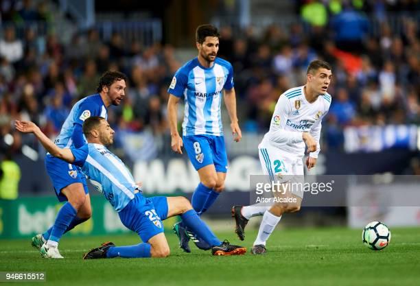Mateo Kovacic of Real Madrid competes for the ball with Medhi Lacen of Malaga during the La Liga match between Malaga CF and Real Madrid CF at...