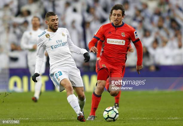 Mateo Kovacic of Real Madrid competes for the ball with Mikel Oyarzabal of Real Sociedad during the La Liga match between Real Madrid and Real...