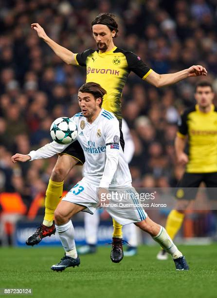 Mateo Kovacic of Real Madrid competes for the ball with Neven Subotic of Borussia Dortmund during the UEFA Champions League group H match between...