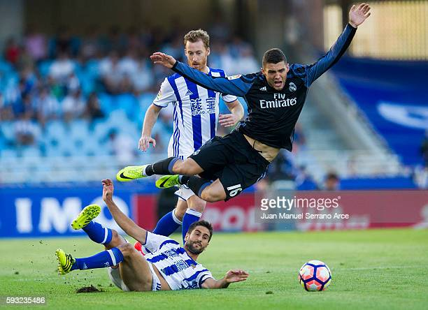 Mateo Kovacic of Real Madrid duels for the ball with Markel Bergara of Real Sociedad during the La Liga match between Real Sociedad de Futbol and...