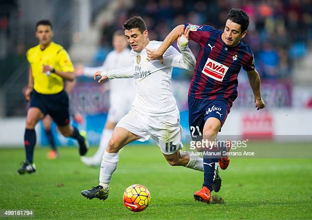 Mateo Kovacic of Real Madrid duels for the ball with Saul Berjon of SD Eibar during the La Liga match between SD Eibar and Real Madrid at Ipurua...