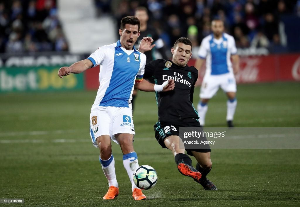 Mateo Kovacic of Real Madrid in action against Gabriel of Leganes during the La Liga football match between Leganes and Real Madrid at the Estadio Municipal Butarque in Madrid, Spain on February 21, 2018.