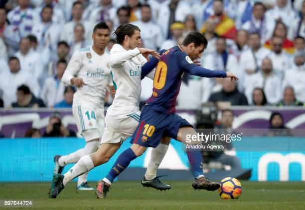 Mateo Kovacic of Real Madrid in action against Lionel Messi of Barcelona during the La Liga match between Real Madrid and Barcelona at Santiago...