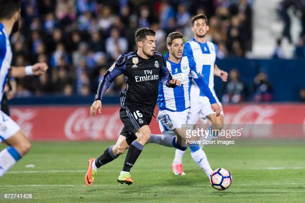 Mateo Kovacic of Real Madrid is challenged by Ruben Perez of Deportivo Leganes during their La Liga match between Deportivo Leganes and Real Madrid...