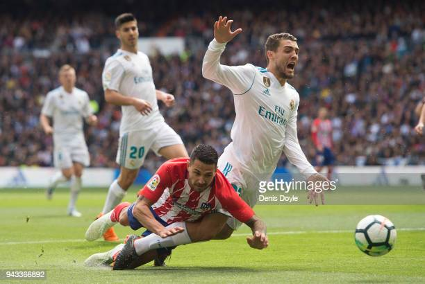 Mateo Kovacic of Real Madrid is challenged by Victor 'Vitolo' Machin of Atletico de Madrid during the La Liga match between Real Madrid and Atletico...