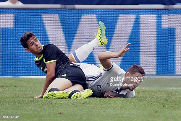 Mateo Kovacic of Real Madrid looks for a foul after being tripped up by Oscar of Chelsea at Michigan Stadium on July 30 2016 in Ann Arbor Michigan
