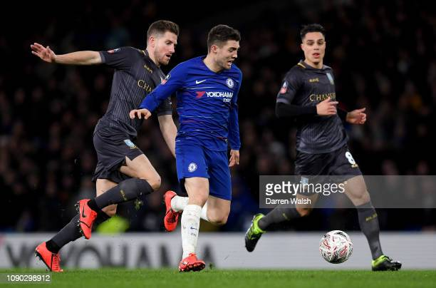 Mateo Kovcic of Chelsea runs with the ball past Sam Hutchinson of Sheffield Wednesday during the FA Cup Fourth Round match between Chelsea and...
