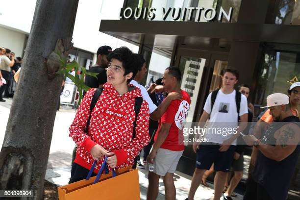 Mateo Lorente wears his new Supreme shirt as people flock to the Louis Vuitton store to purchase limited edition supreme and Louis Vuitton...