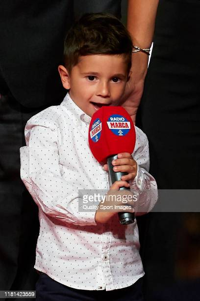Mateo Messi son of Lionel Messi of FC Barcelona plays with a microphone during the Golden Shoe Award Ceremony at Antiga Fabrica Estrella Damm on...