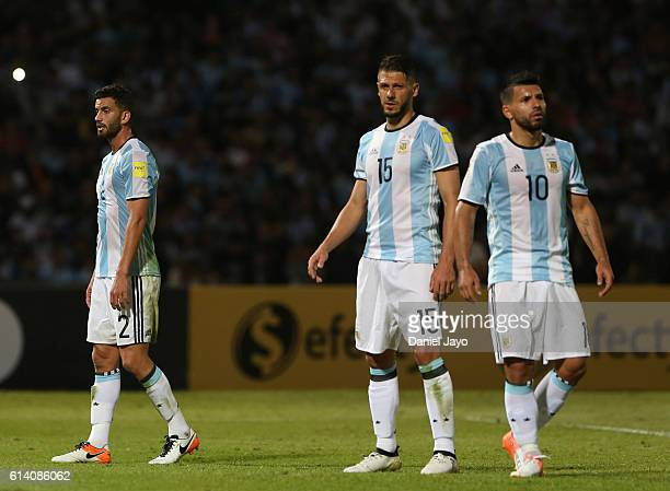 Mateo Musacchio Martin Demichelis and Sergio Aguero walk during a match between Argentina and Paraguay as part of FIFA 2018 World Cup Qualifiers at...