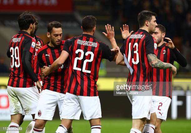 Mateo Musacchio of AC Milan celebrates with his teammates after scoring the opening goal during the Serie A match between AC Milan and US Sassuolo at...
