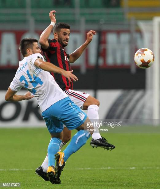 Mateo Musacchio of AC Milan competes for the ball with Domagoj Pavicic of HNK Rijeka during the UEFA Europa League group D match between AC Milan and...