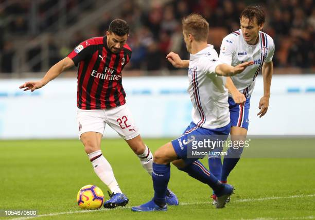 Mateo Musacchio of AC Milan competes for the ball with Joachim Andersen and Albin Ekdal of UC Sampdoria during the Serie A match between AC Milan and...