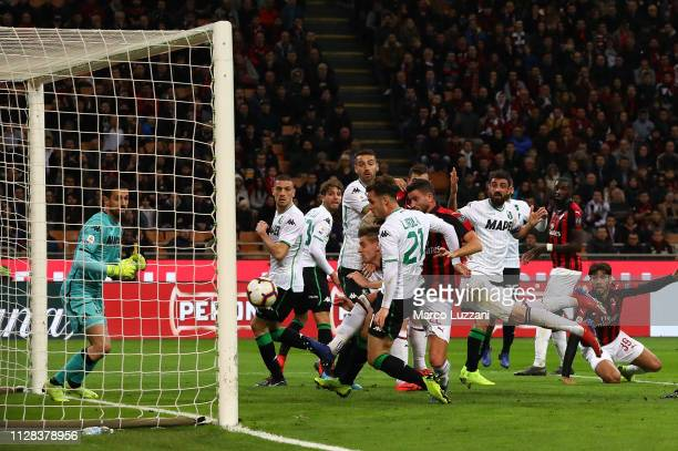 Mateo Musacchio of AC Milan scores the opening goal during the Serie A match between AC Milan and US Sassuolo at Stadio Giuseppe Meazza on March 2...