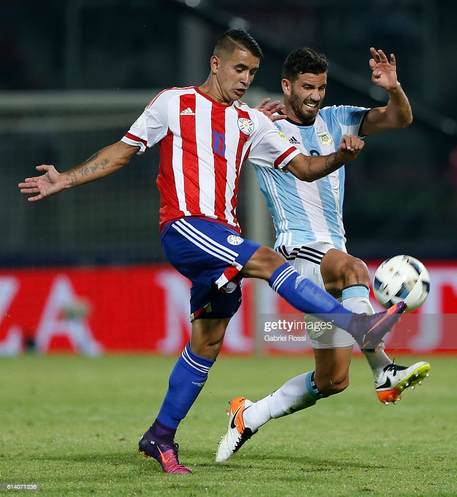 Mateo Musacchio, of Argentina, fights for the ball with Derlis Gonzalez, of Paraguay, during a match between Argentina and Paraguay as part of FIFA 2018 World Cup Qualifiers at Mario Alberto Kempes Stadium on October 11, 2016 in Cordoba, Argentina.
