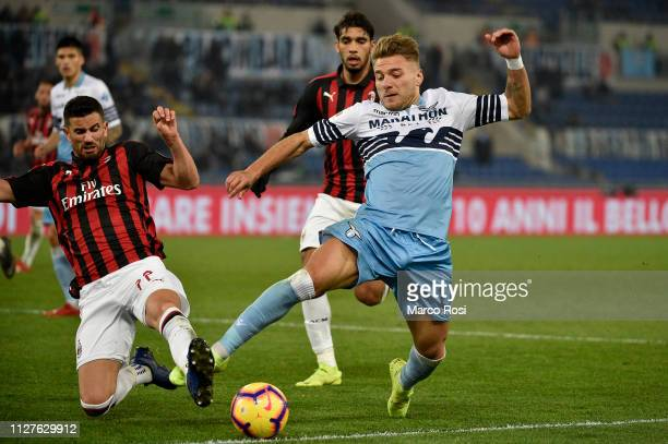 Mateo Pablo Musacchio of AC Milan competes for the ball with Ciro Immobile of SS Lazio during the Coppa Italia semifinal first leg between SS Lazio...