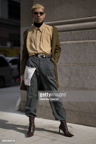 Mateo Palacio is seen attending Raun LaRose wearing olive coat tan shirt grey pants with custom pencil design patch and brown heels on February 1...