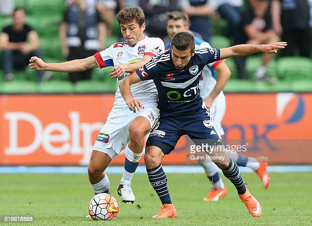 Mateo Poljak of the Jets and Kosta Barbarouses of the Victory compete for the ball during the round 24 ALeague match between the Melbourne Victory...