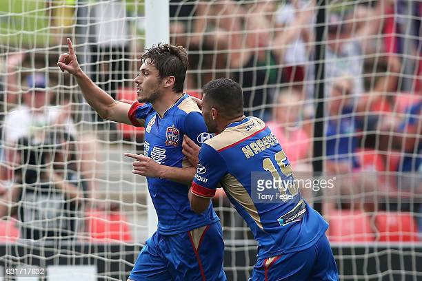 Mateo Poljak of the Jets celebrates a goal with team mate Andrew Nabbout during the round 15 ALeague match between the Newcastle Jets and the Perth...