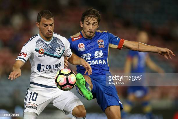 Mateo Poljak of the Jets contests the ball with James Troisi of the Victory during the round 19 ALeague match between the Newcastle Jets and...