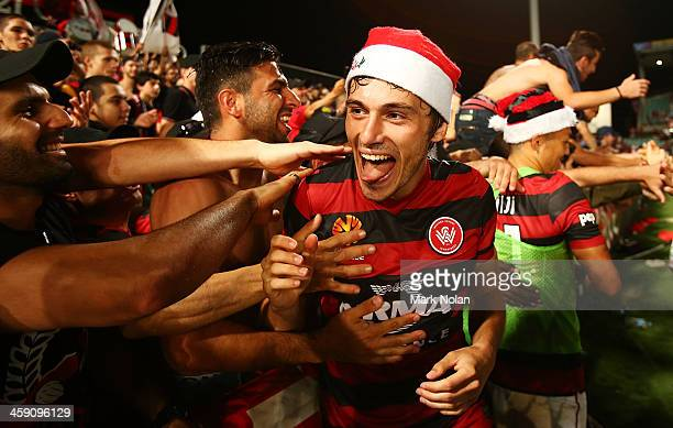 Mateo Poljak of the Wanderers celebrates with fans after winning the round 11 ALeague match between the Western Sydney Wanderers and the Central...
