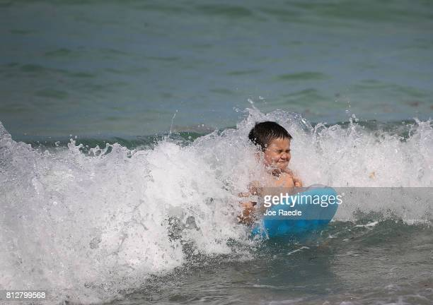 Mateo Saez enjoys the ocean water off of Haulover Beach where a rare shark attack occured on Sunday afternoon on July 11 2017 in Sunny Isles Florida...