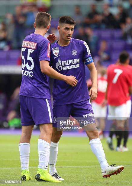 Mateo Tadic and Stefan Jonovic of Young Violets celebrate during the friendly match between Young Violets Austria Wien and Manchester United U23 at...