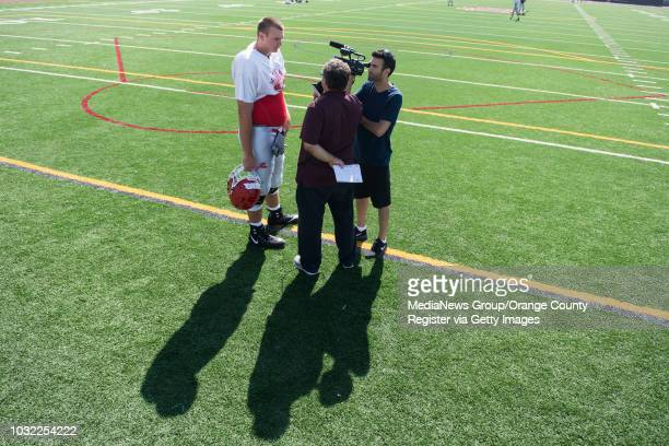 Mater Dei offensive lineman Tommy Brown is interviewed by the Orange County Register's Dan Albano and Johnathan Khamis in Santa Ana CA on Friday...