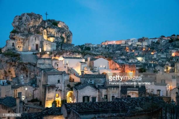 matera, basilicata, italy. scenic view by night of historic town with the church of the madonna de idris - iacomino italy foto e immagini stock