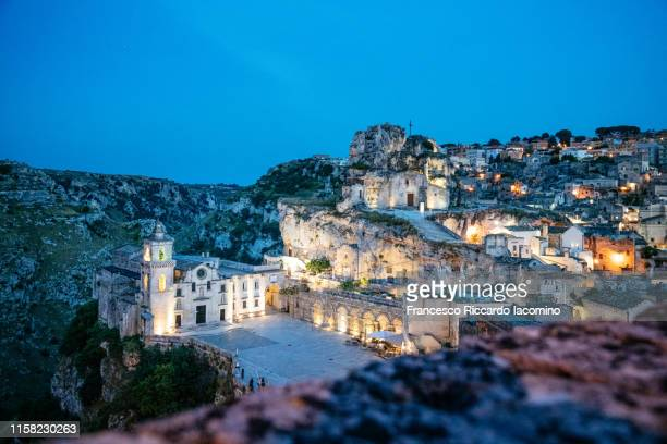 matera, basilicata, italy. scenic view by night of historic town with the church of the madonna de idris - basilicata region stock pictures, royalty-free photos & images