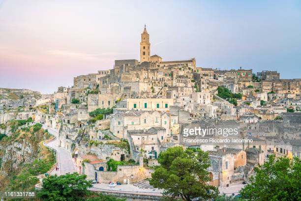 matera, european capital of culture 2019, sunset townscape. - matera italy stock pictures, royalty-free photos & images