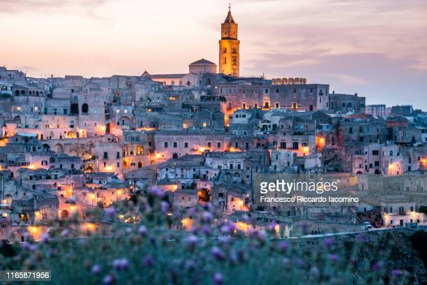 matera, townscape at sunset from belvedere della murgia. basilicata, italy - basilicata region stock pictures, royalty-free photos & images